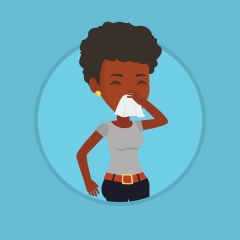 Young african-american sick woman sneezing.